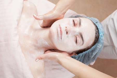 Beautiful woman with clear skin getting beauty treatment of her face at salon   Clear Skin  photo