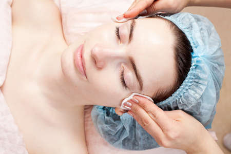 Beautiful woman with clear skin getting beauty treatment of her face at salon   Clear Skin  Stock Photo - 12783845