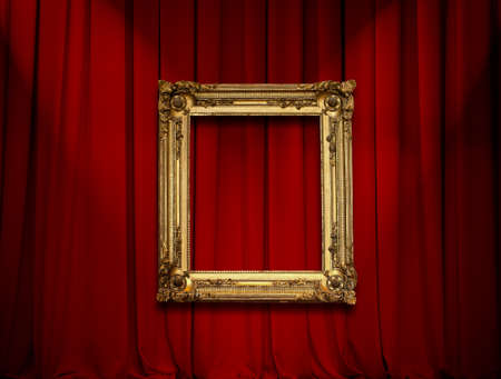 Empty golden painting frame on red curtain wall photo