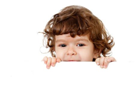 Curly funny child face holding blank advertising banner photo
