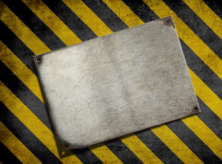 old metal plate background with hazard stripes photo