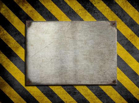 hazard stripes: old metal plate background with hazard stripes