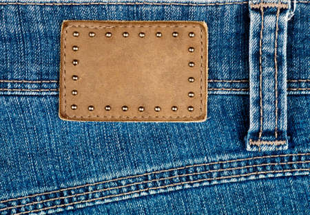 Blank leather jeans label decorated by rivets photo