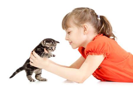 british girl: Girl lying with British kitten isolated on white