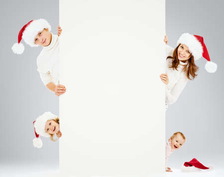 Happy family in Santa Stock Photo - 13774379