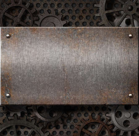 metal plate over rusty gears background Stock Photo - 13774382