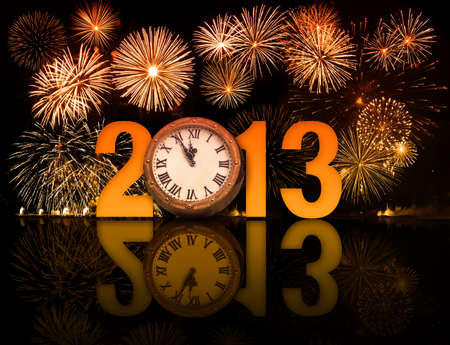 displaying: 2013 year with fireworks and clock displaying 5 minutes before midnight