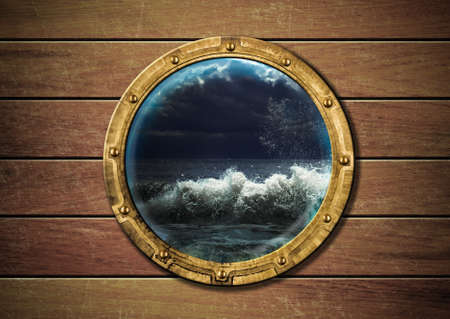 ship porthole with storm outside photo