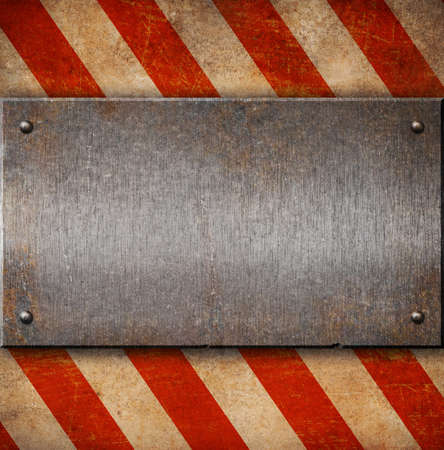 Grunge metal plate with white and red stripes photo