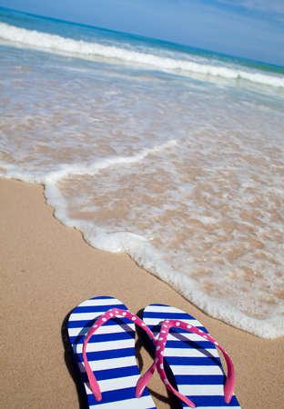 flip flop: Colorful flip-flop sandals on sea beach Stock Photo