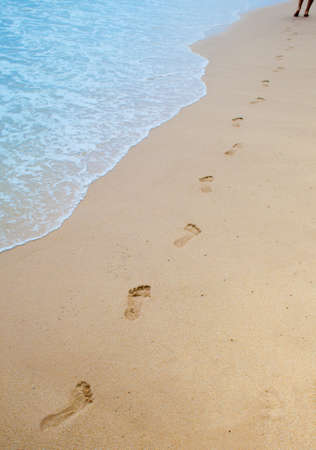Footprints on sand of sea beach photo