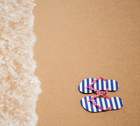 breeze: Colorful flipflop pair on sea beach top view Stock Photo