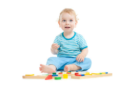 Happy child playing educational toys isolated on white photo