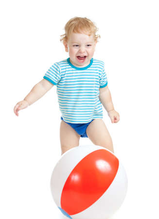 Red panties: Happy child playing with colorful ball isolated on white