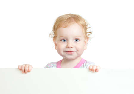 Curly cute child face holding blank advertising banner photo