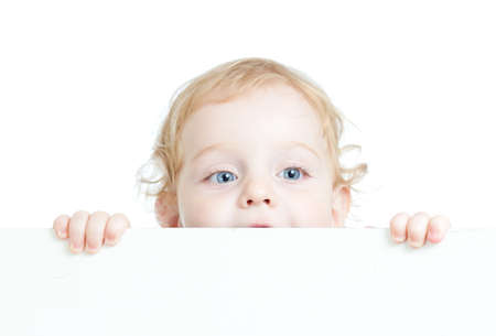 Curly cute child holding blank advertising banner photo