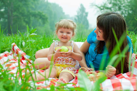 mother and daughter have picnic eating healthy food outdoor photo