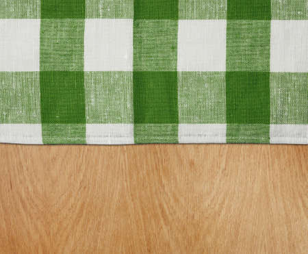 table top view: wooden kitchen table with green gingham tablecloth