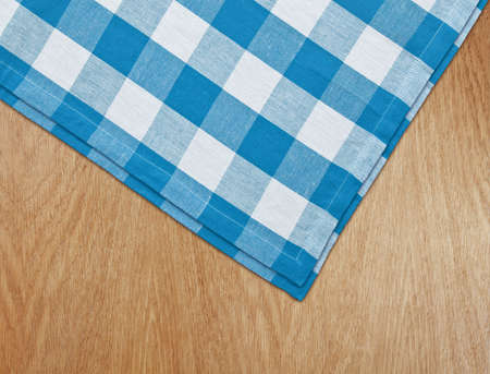 wooden kitchen table with blue gingham tablecloth photo