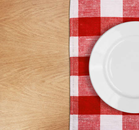 white plate on table with red checked tablecloth Stock Photo - 14898520