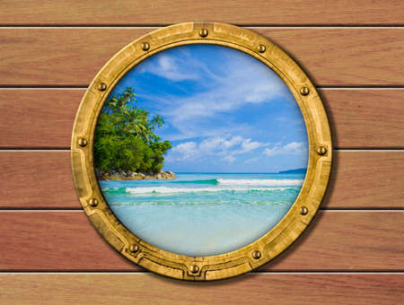 ship porthole with tropical island behind photo