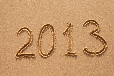 new year 2013 digits on ocean beach sand photo