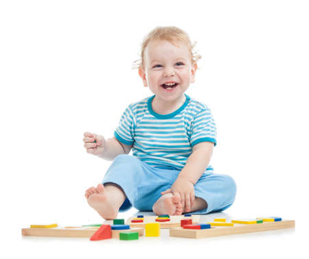 happy child playing educational toys on floor photo