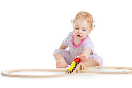 toy train: child is playing with wooden train isolated on white Stock Photo