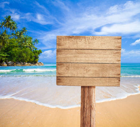 a signboard: wooden signboard on tropical beach