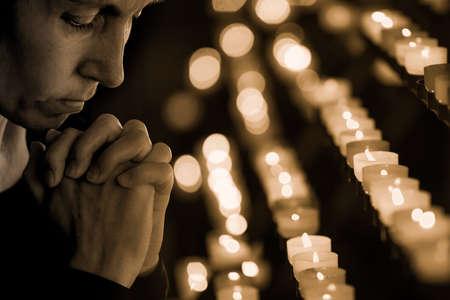 Woman praying in church photo