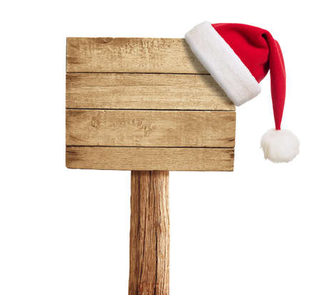 wooden plaque: wooden signboard with Christmas hat isolated on white