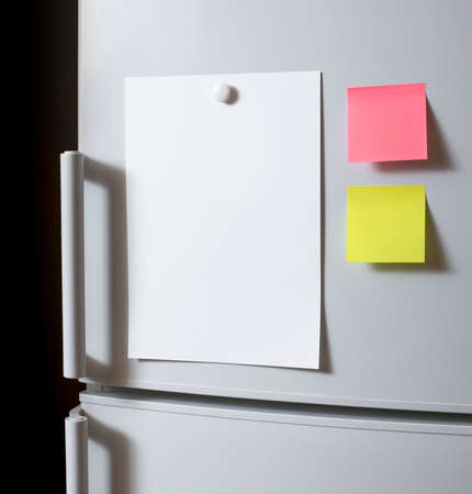 refrigerator: Empty paper sheet on fridge door