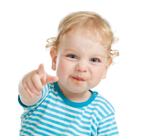 demanding: funny curly child with dirty lips pointing by finger directly to camera