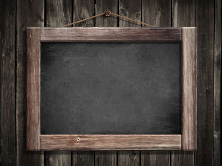 Grunge small blackboard hanging on wooden wall as a background for your message