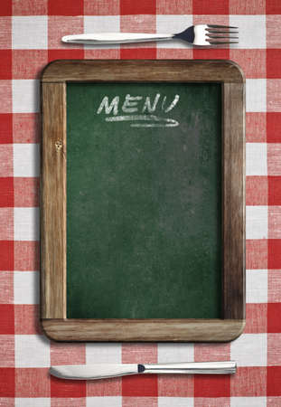 red gingham: Menu blackboard lying on table with knife and fork