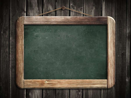 Aged green blackboard hanging on wooden wall as a background for your message photo