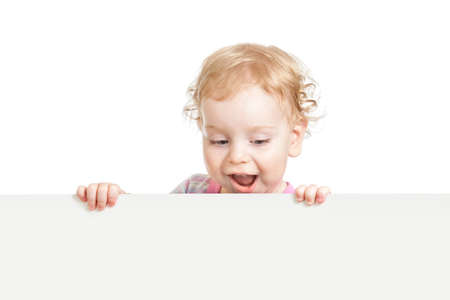 kid looking down behind white emty banner isolated Stock Photo