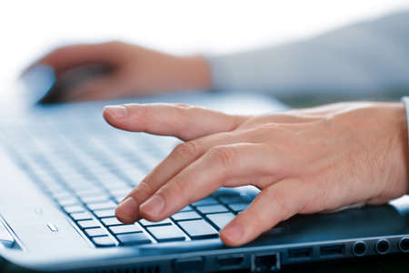 Hands typing on laptop keyboard photo