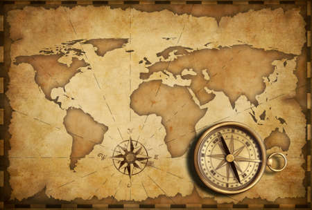 vintage world map: aged brass antique nautical pocket compass with old map Stock Photo