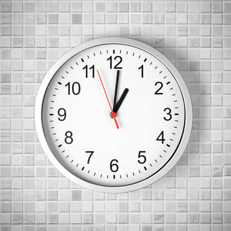 wall clock: Simple clock or watch on white tile wall displaying one oclock