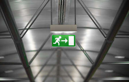 exit sign: green emergency exit sign in public building Stock Photo
