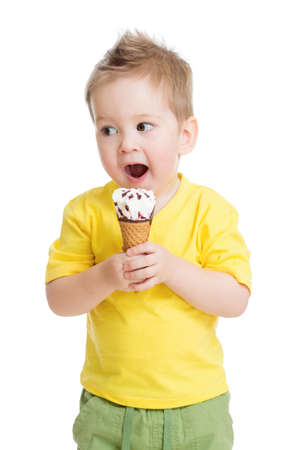 Child or kid eating ice cream isolated on white photo