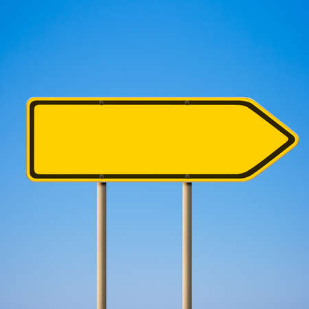 Blank yellow road sign, direction pointer to right against blue sky photo
