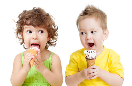 children or kids, little girl and boy eating ice cream isolated on white