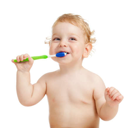 Smiling kid brushing teeth photo