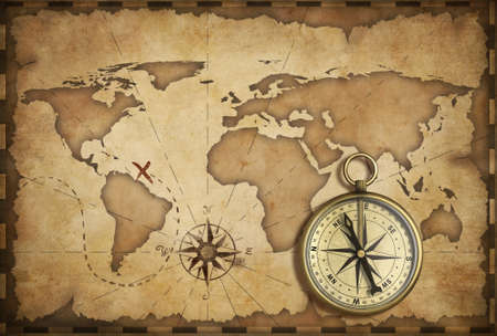 aged brass antique nautical compass and old map with track on it
