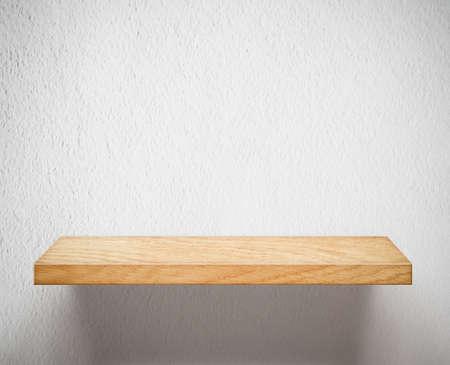 wooden shelf: Wooden shelf on white wall Stock Photo