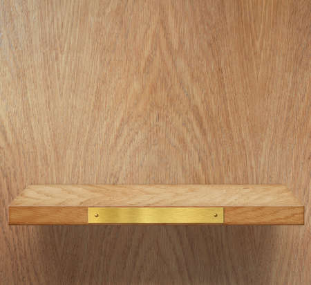 Empty wooden shelf with brass metal plate photo