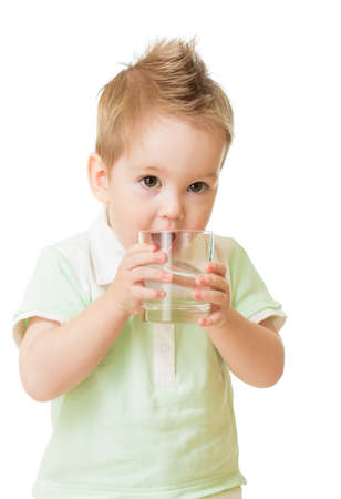 Boy drinking water from glass isolated on white photo