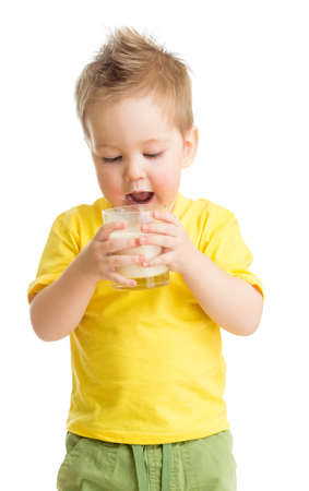 kid drinking dairy product from glass isolated on white photo